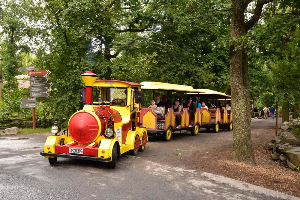 Small train carrying people around Scansen open air museum