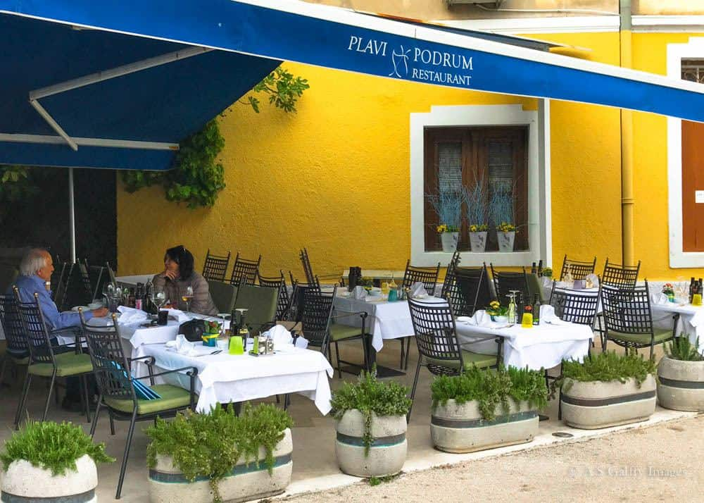 View of Plavi Podrum restaurant that you'll encounter when strolling Lungomare