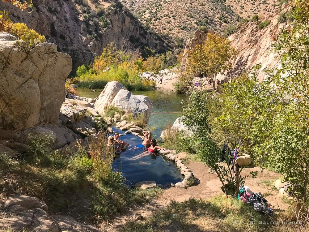 People soaking in the hot pools at the Deep Creek Hot Springs