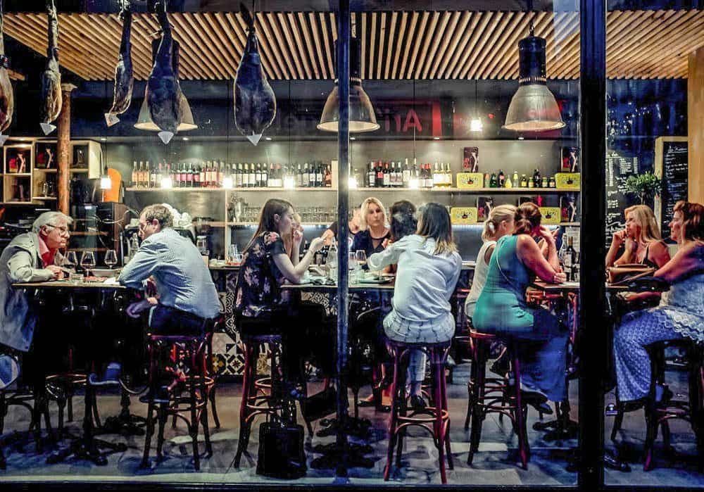Image depicting people dining late at night in Europe