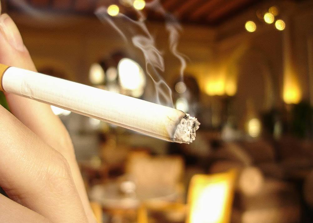 Image depicting a smoker with a cigarette