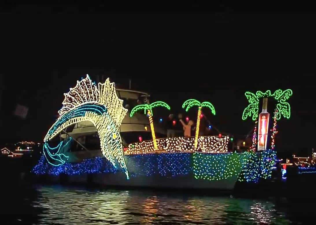 View of a boat decorated with lights floating on the water